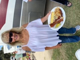 Kathy M. getting ready to enjoy breakfast